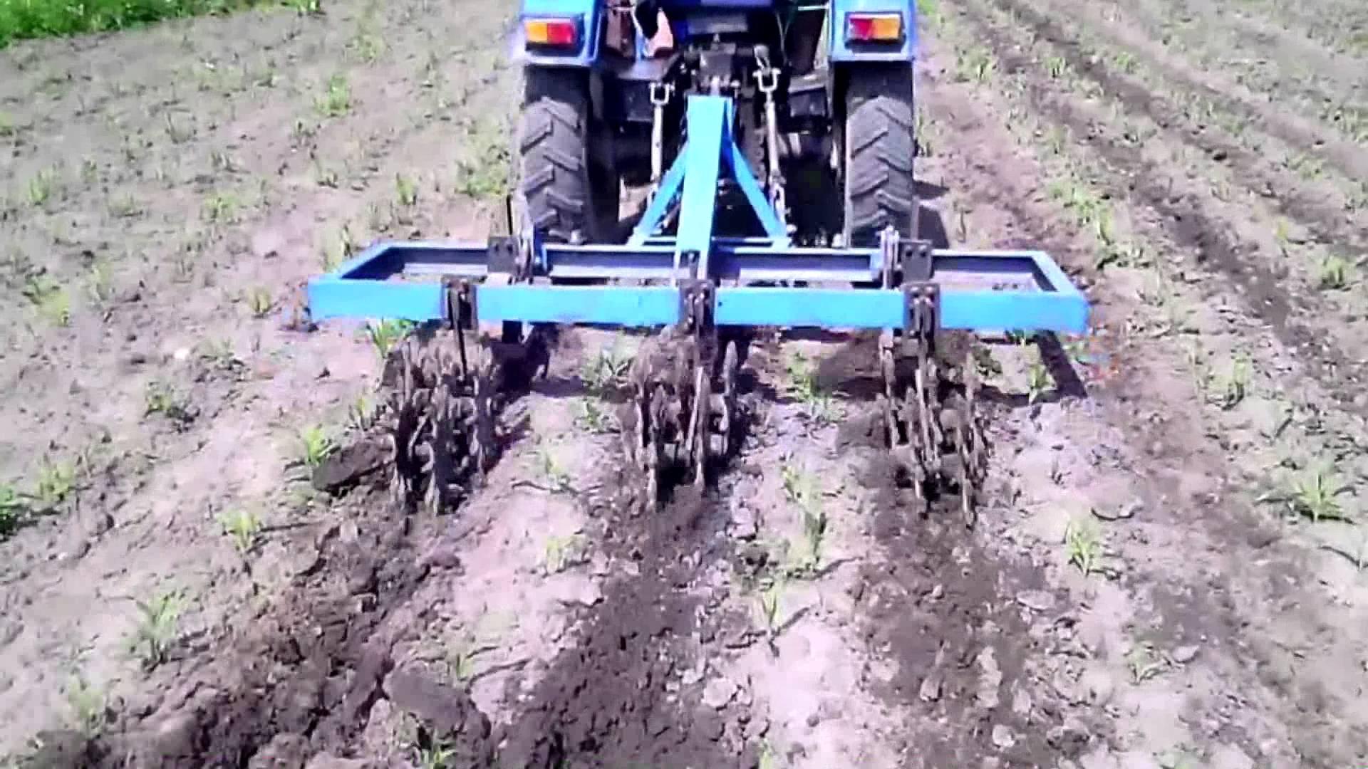 Трактор Синтай 220 в работе